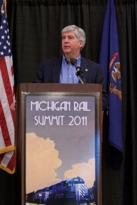 Michigan Governor Rick Snyder addressing the audience at the 2011 Michigan Rail Summit, in Lansing, Michigan